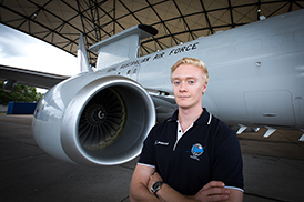 Karl Domjahn in front of a Royal Australian Air Force aircraft.